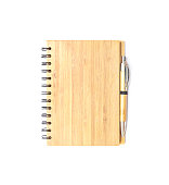 Closeup wooden note book with pen isolated on white background