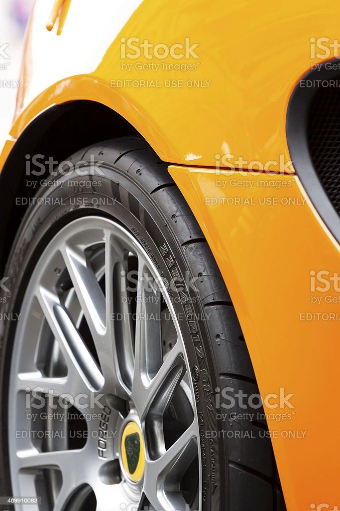 Closeup yellow Lotus car alloy wheel stock photo