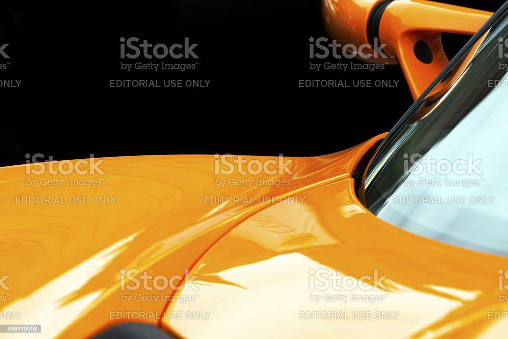Closeup yellow Lotus car bonnet against black background, copy space stock photo