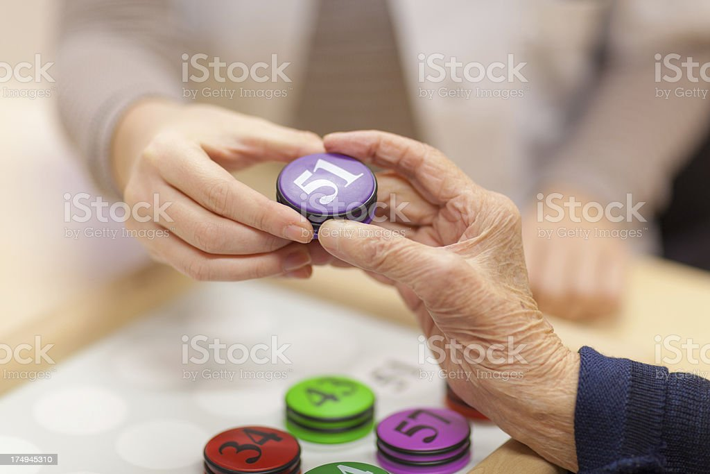 closeup young and old hand holding number stock photo