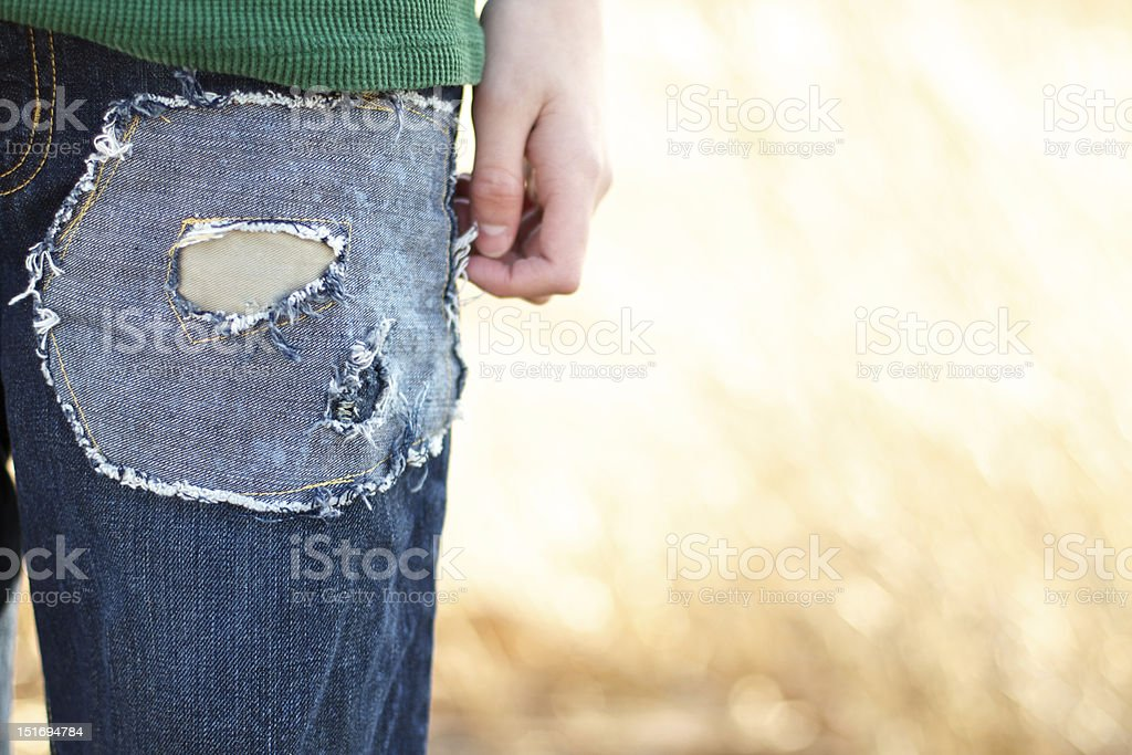 Closeup Young boys patched fashion blue jeans stock photo