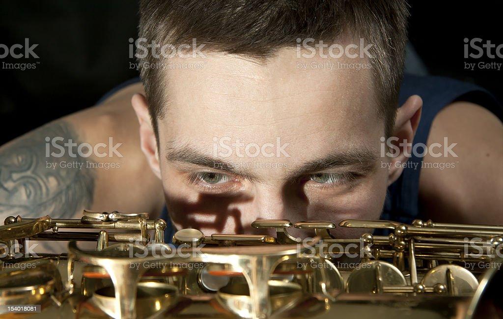 closeup young jazz man look on saxophone stock photo
