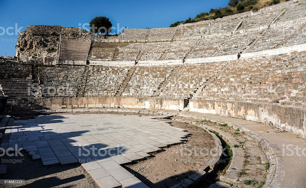 A close-view of an amphitheater against a blue sky stock photo