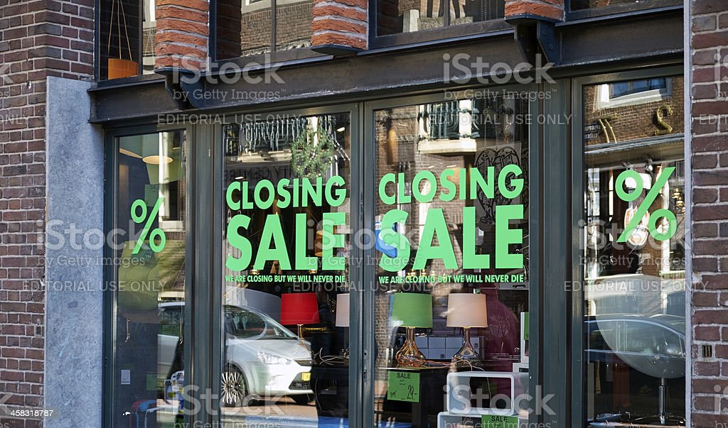 Closing sale signs in window stock photo