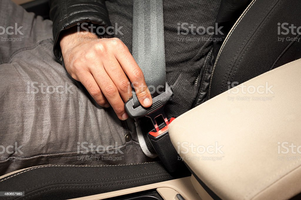 Closing seat belt stock photo