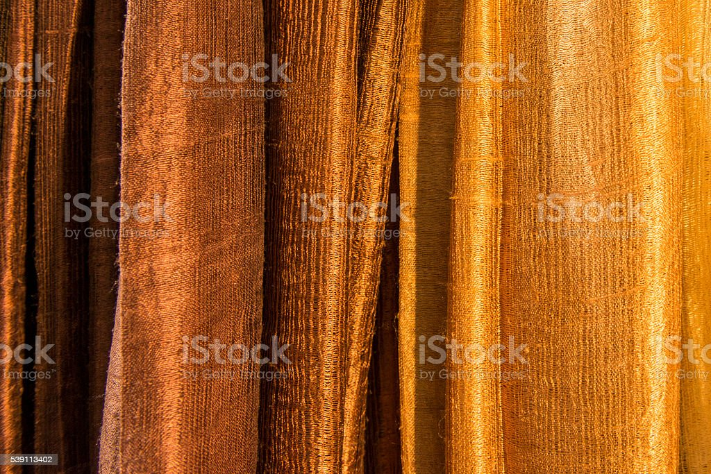 cloth in a row with shades of brown stock photo