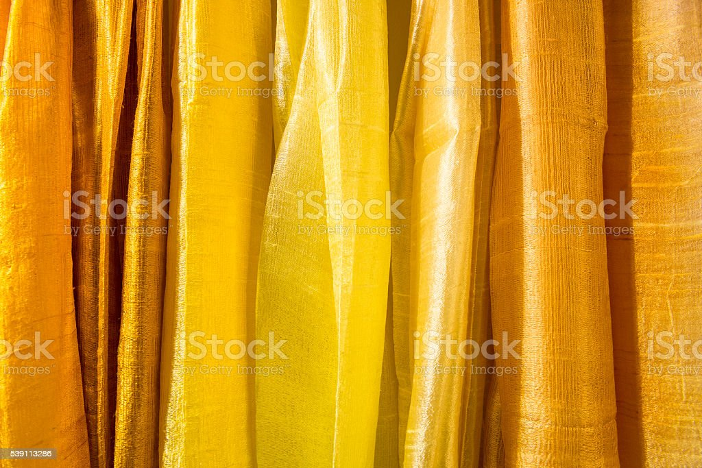cloth in a row with shades of orange stock photo
