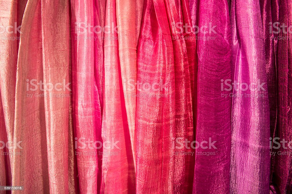 cloth in a row with shades of pink stock photo