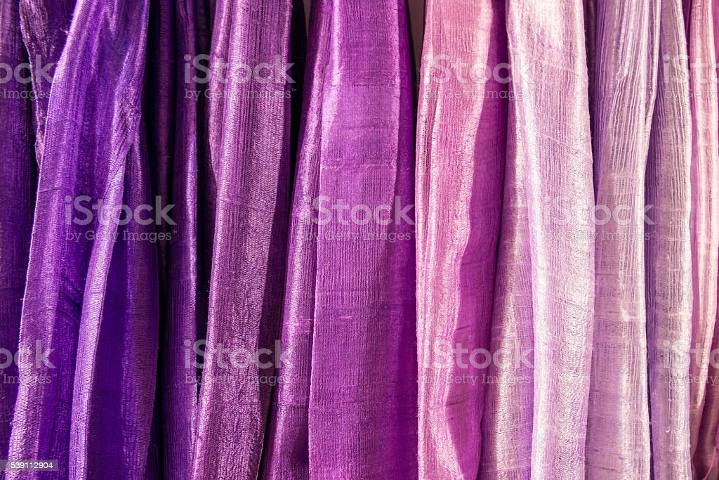 cloth in a row with shades of purple stock photo