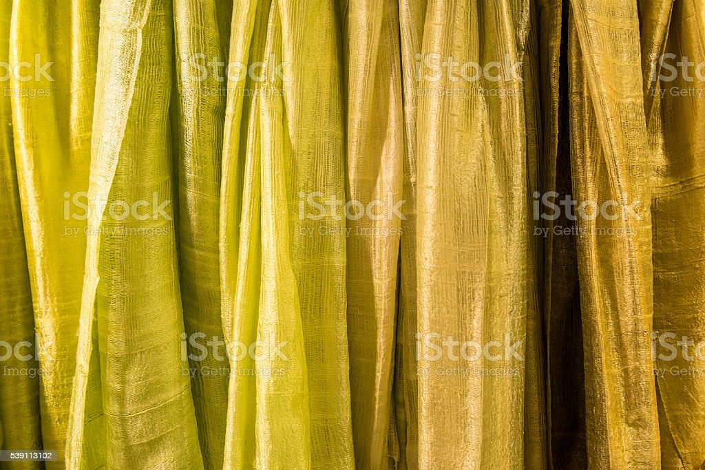 cloth in a row with shades of yellow stock photo