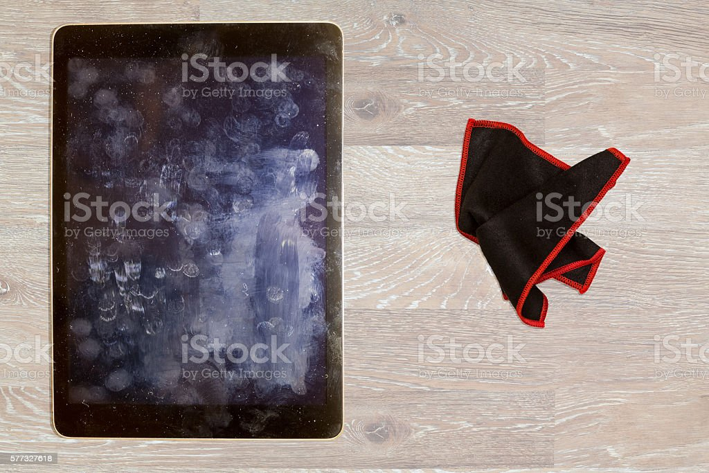Cloth to wipe fingerprints and grease on tablet screen stock photo