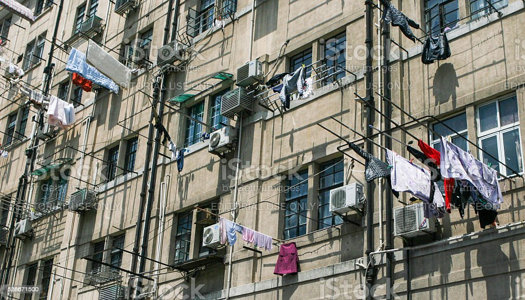 Clothes being hanged outside flat of an oldl building stock photo