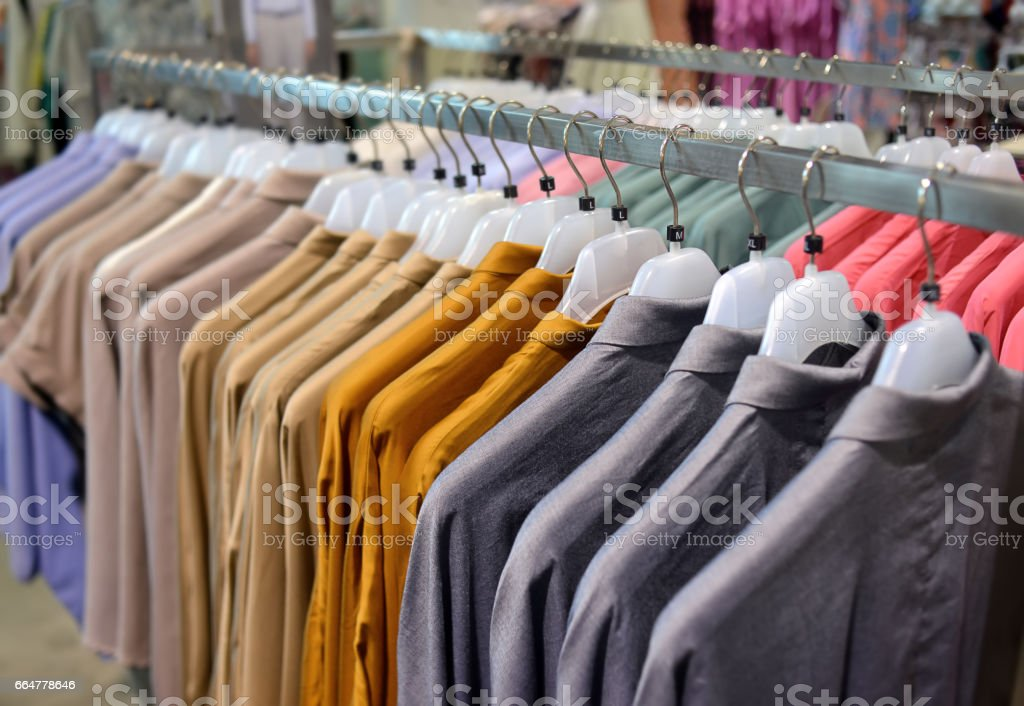 Clothes collection in hangers for sale. stock photo