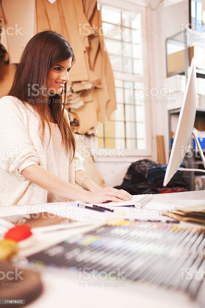 Clothes desingner in her studio. royalty-free stock photo