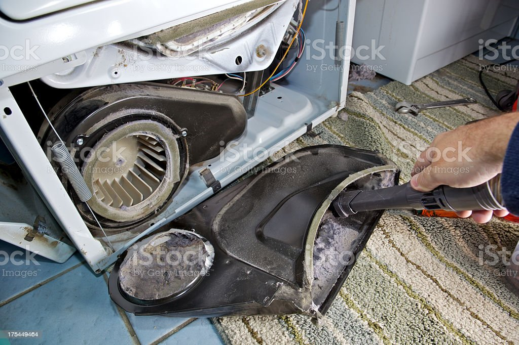 Clothes Dryer Repair Removing Dust from Inside machine royalty-free stock photo