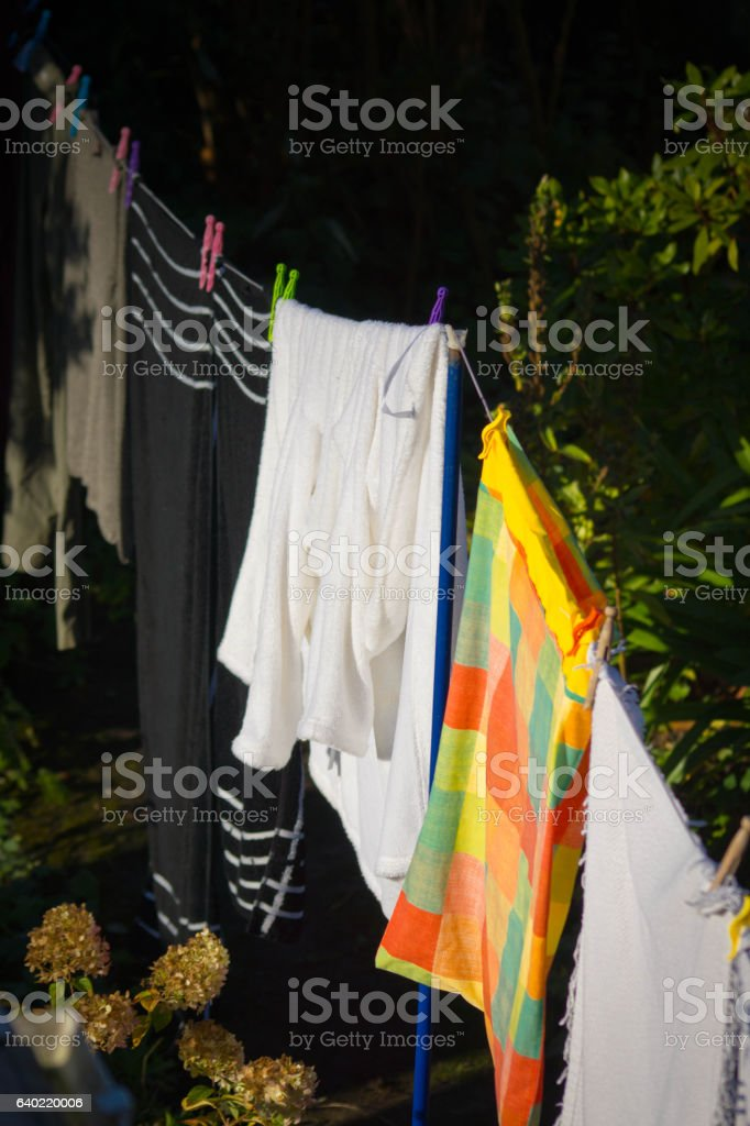 Clothes drying on a clothes line stock photo