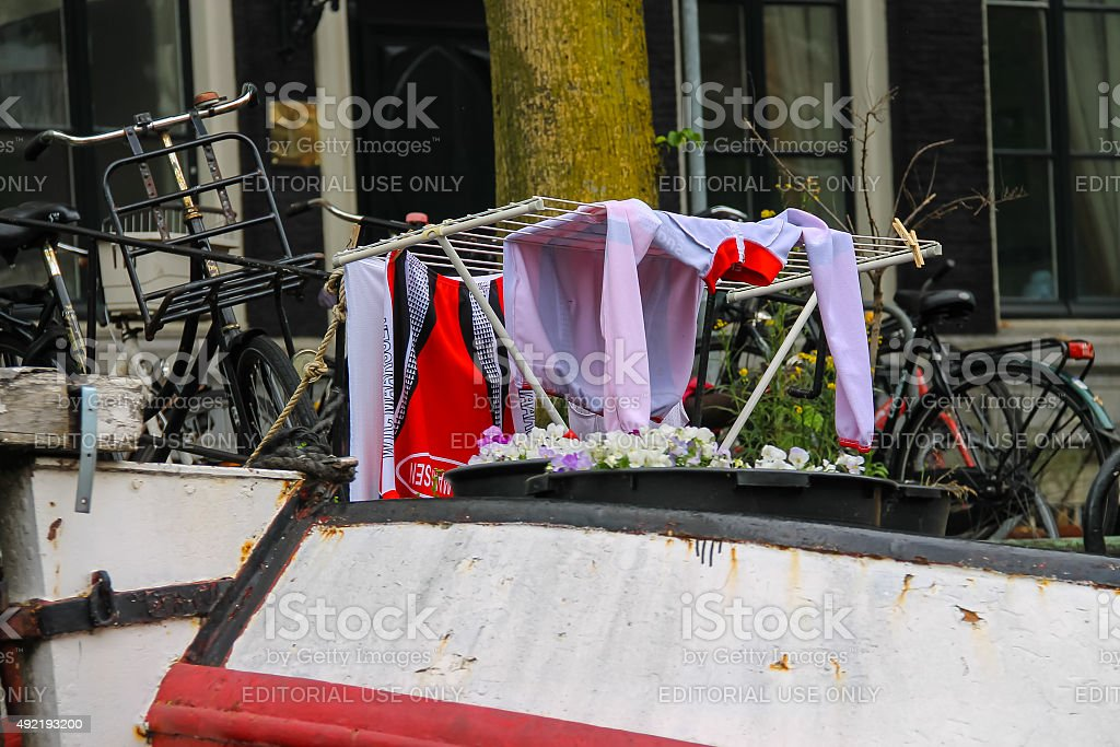 Clothes drying on  a ship on the canal in Amsterdam stock photo