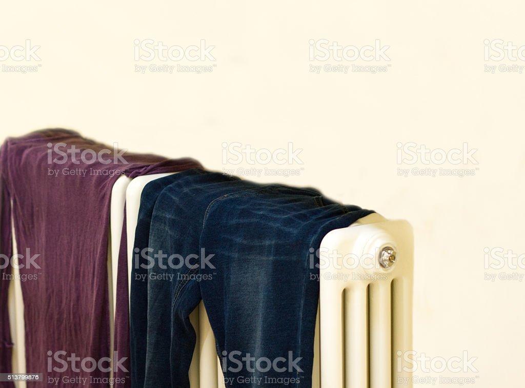 Clothes Drying on White Retro Radiator (Close-Up) stock photo