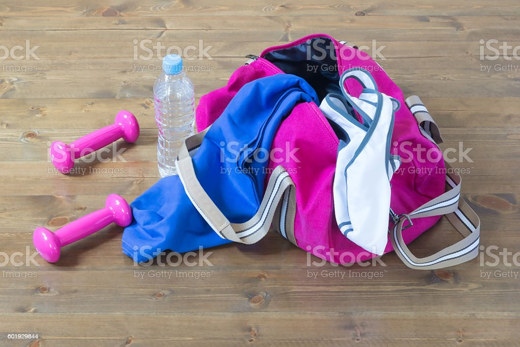 Clothes for sports with pink dumbbells stock photo