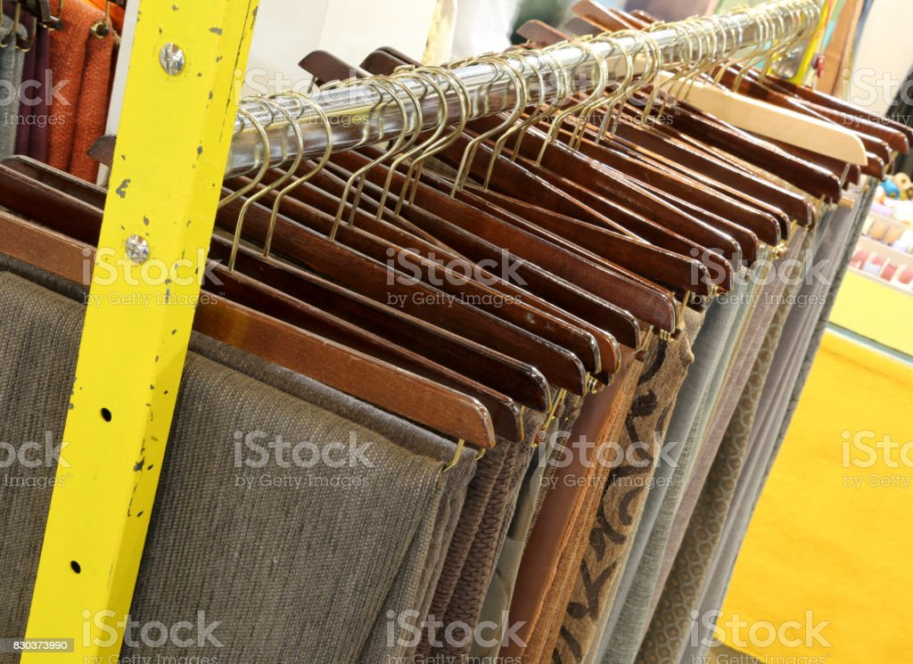 clothes hanging for sale in the store stock photo