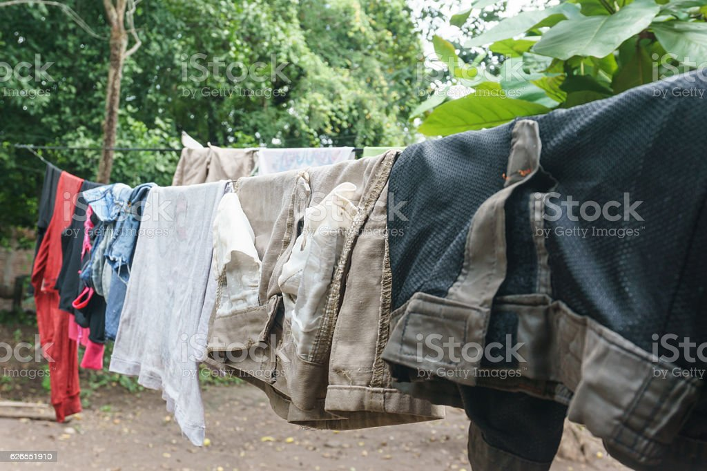 Clothes hanging in a poor house on Nicaragua. stock photo