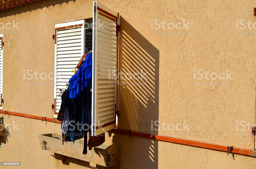 clothes hanging on a shutter of a south french building stock photo