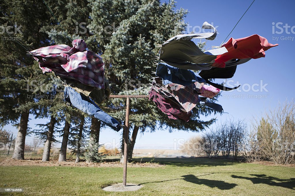 Clothes Hanging on Clothesline in Strong Wind royalty-free stock photo