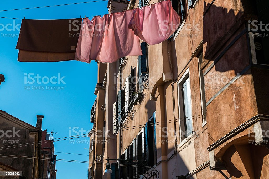Clothes hanging out to dry on a traditional Venice street royalty-free stock photo