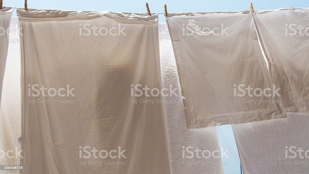 clothes hanging out to dry stock photo
