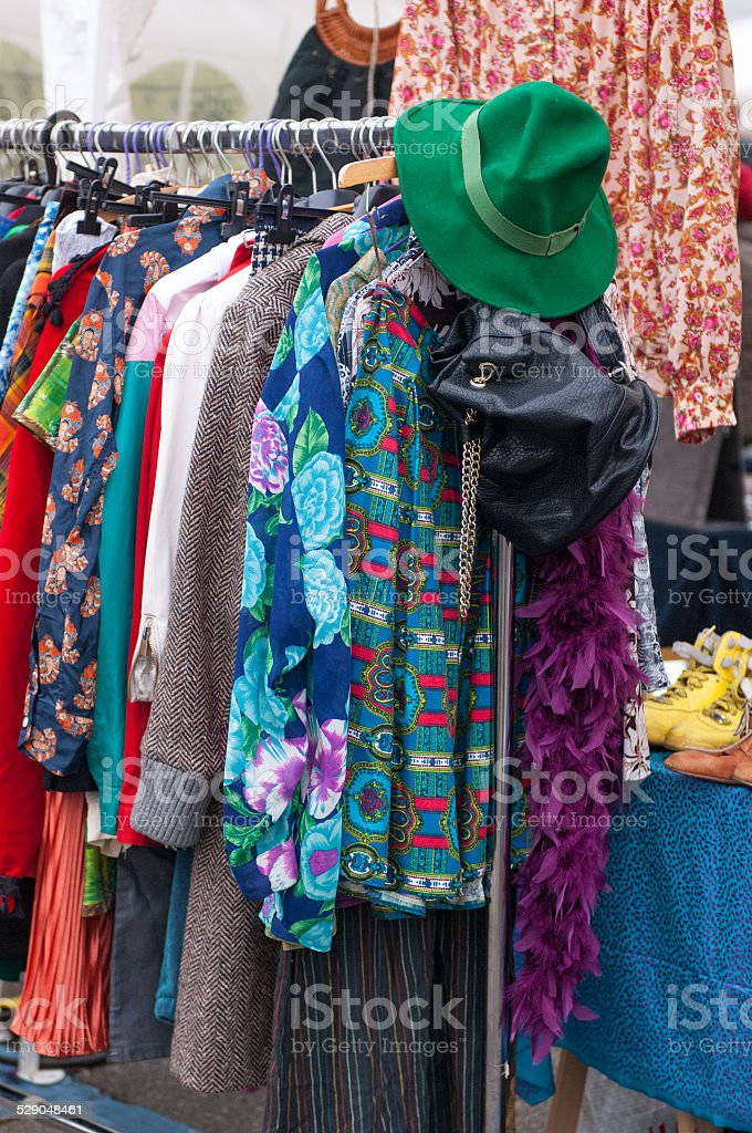 clothes in a street market stock photo