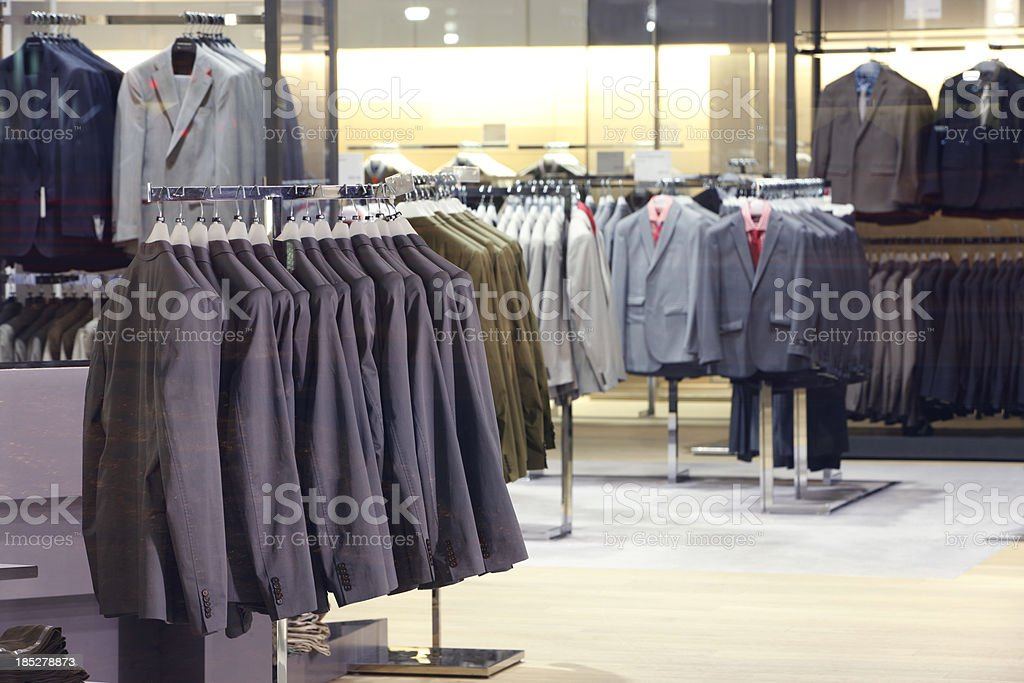Clothes in storefront window. stock photo