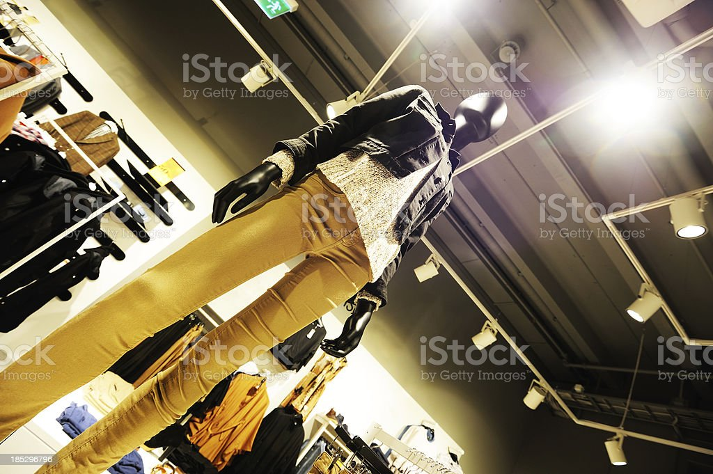 Clothes on dummy mannequins against spotlights royalty-free stock photo