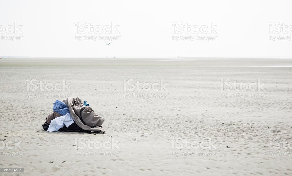 Clothes on the beach stock photo