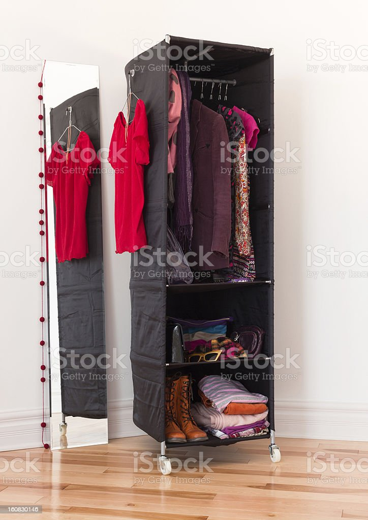 Clothes organizer with clothing and accessories royalty-free stock photo