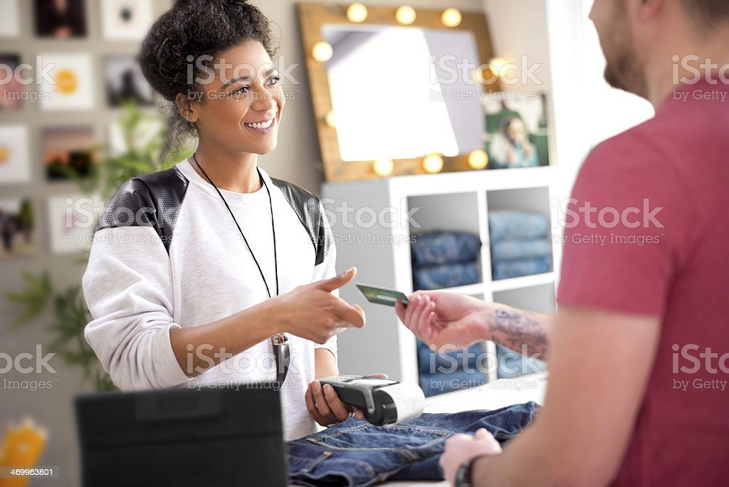 Clothes shop sales assistant stock photo
