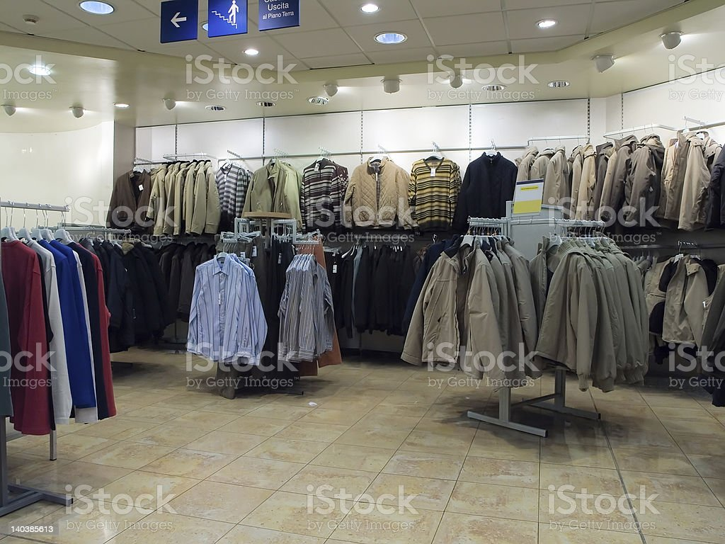 A clothes shop with lots of tan coats royalty-free stock photo