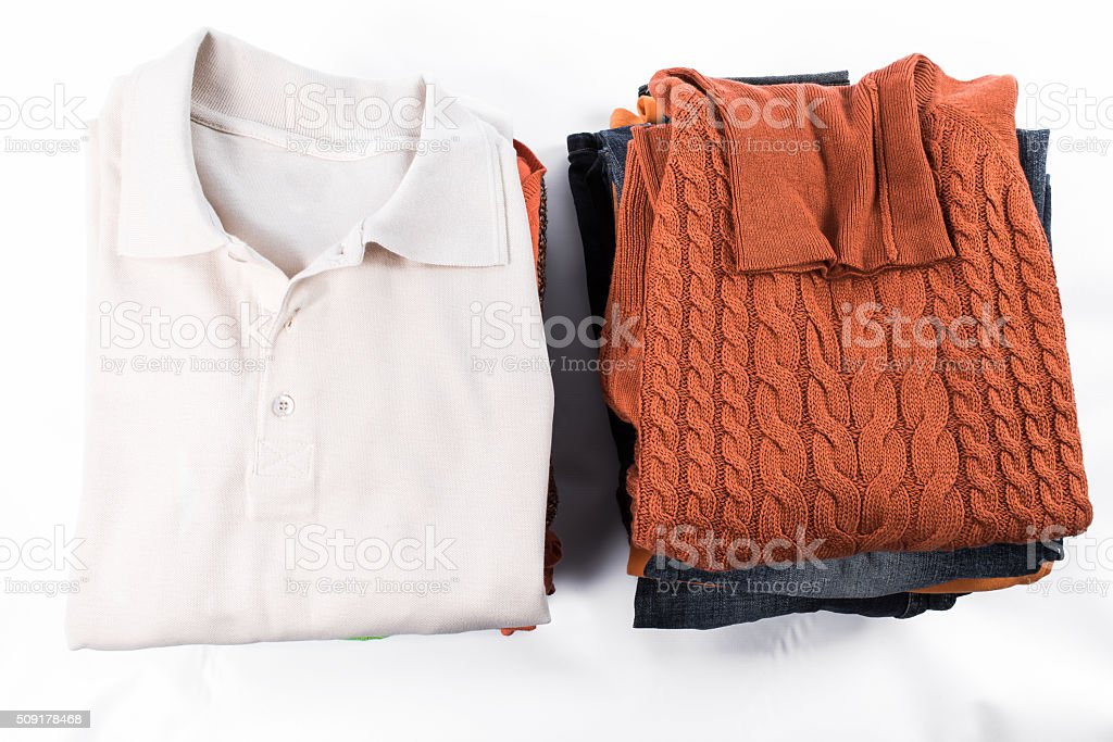 Clothes stacked over white stock photo