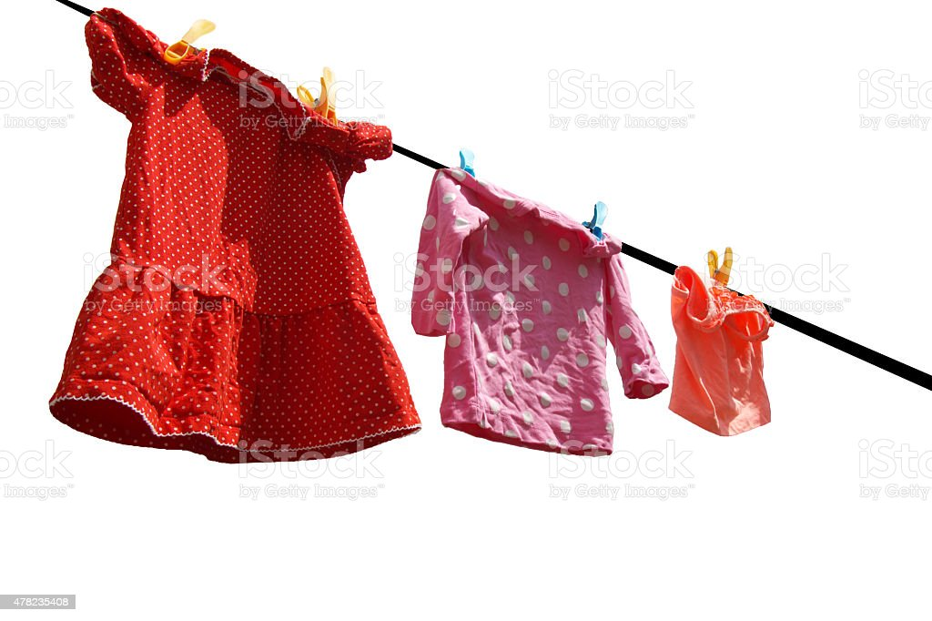 clothesline with baby clothes stock photo