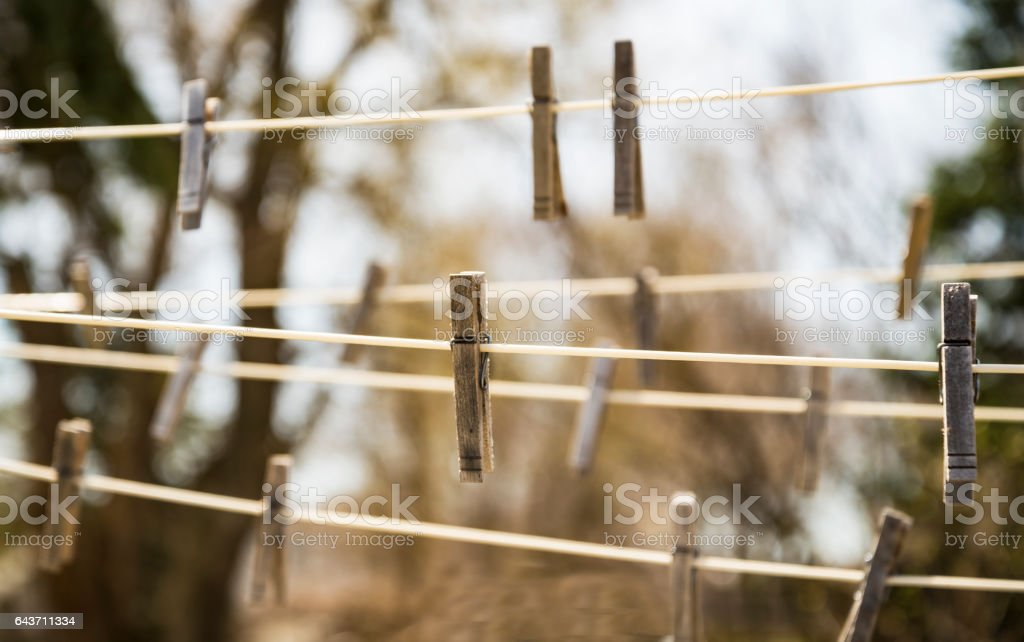 Clothespin hanged on ropes stock photo