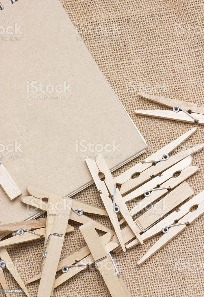 Clothespin with notebook on sackcloth. royalty-free stock photo