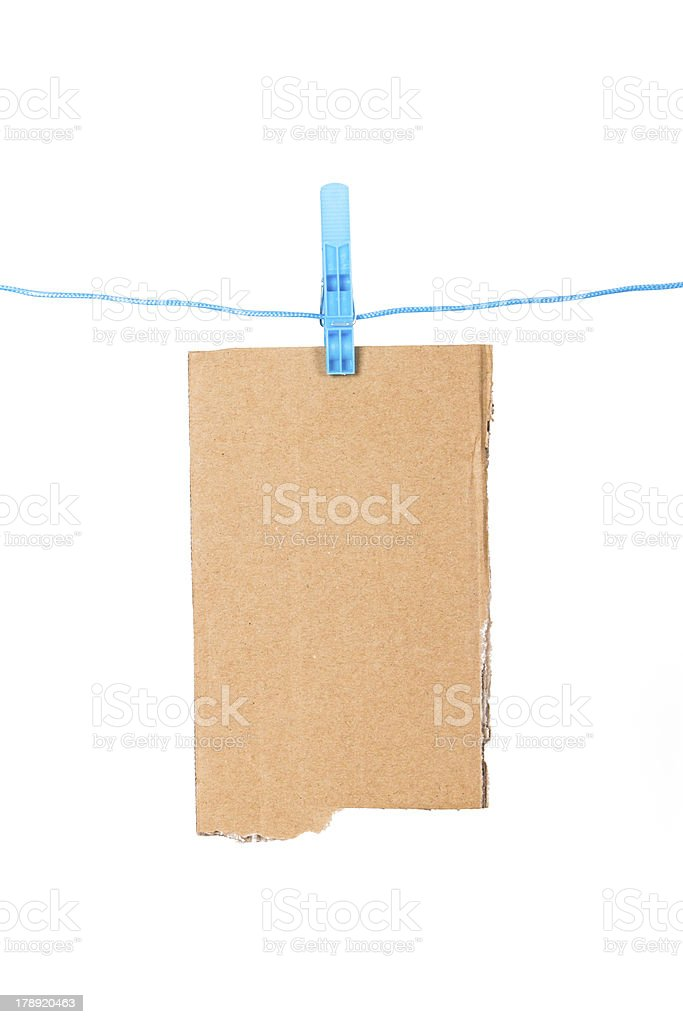 Clothespin with Ripped Cardboard stock photo