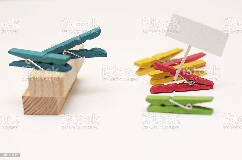 Clothespins acting as a politics royalty-free stock photo