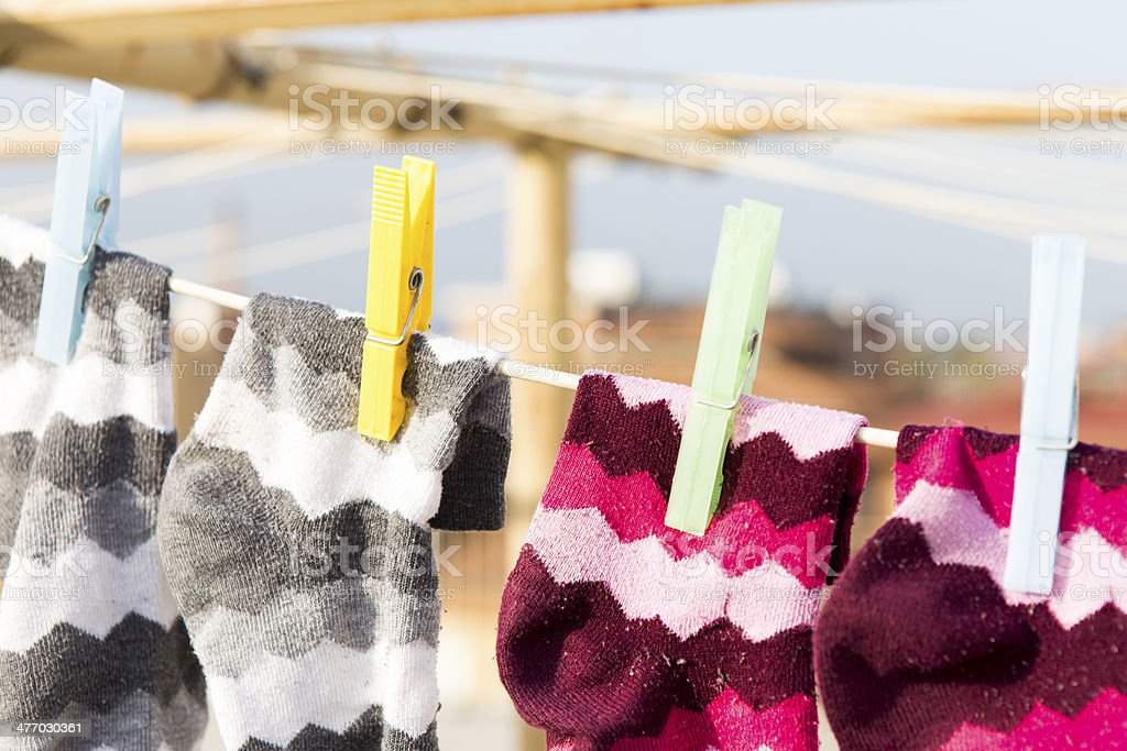 Clothespins and socks royalty-free stock photo