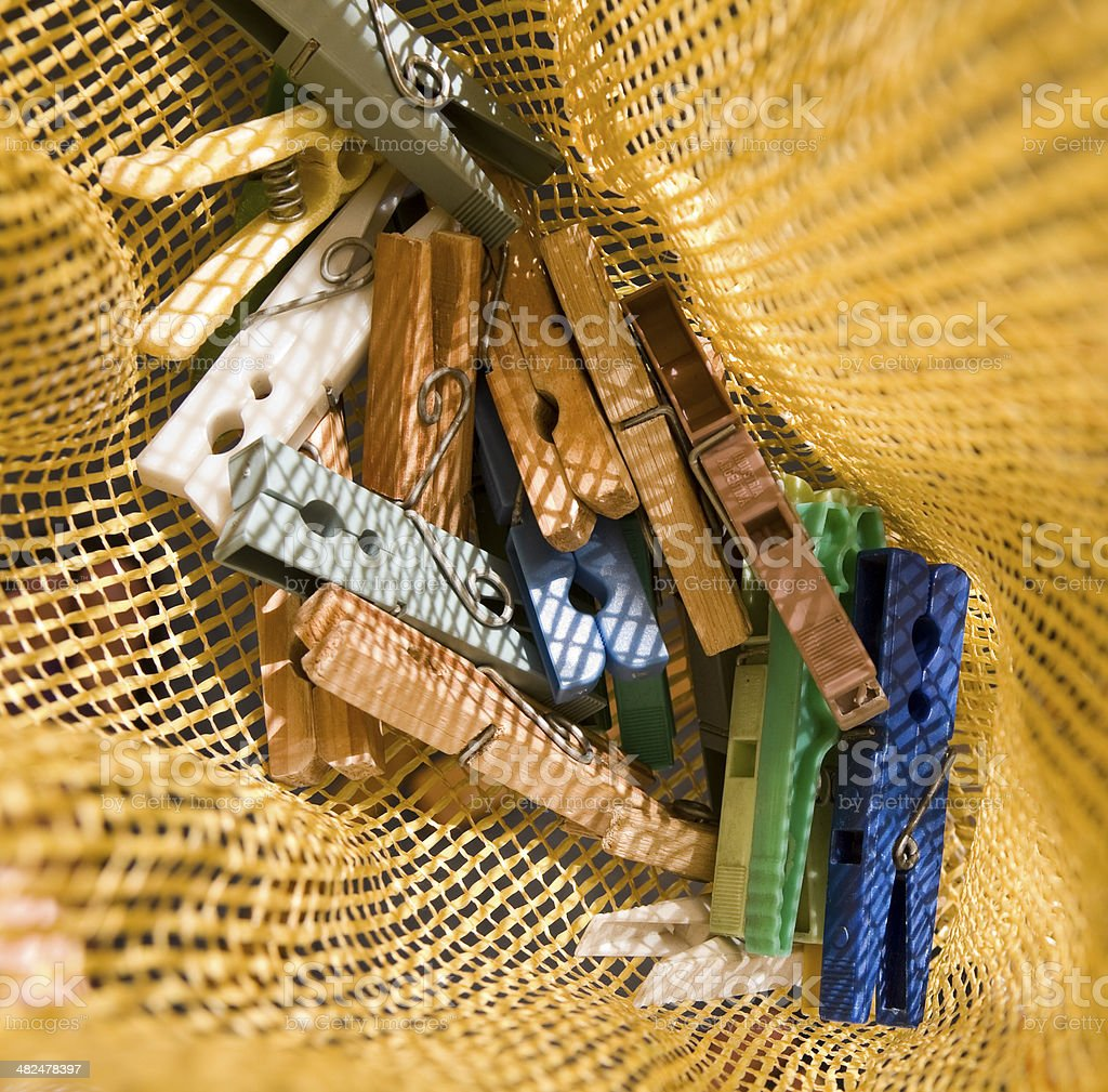 Clothespins in plastic bag stock photo