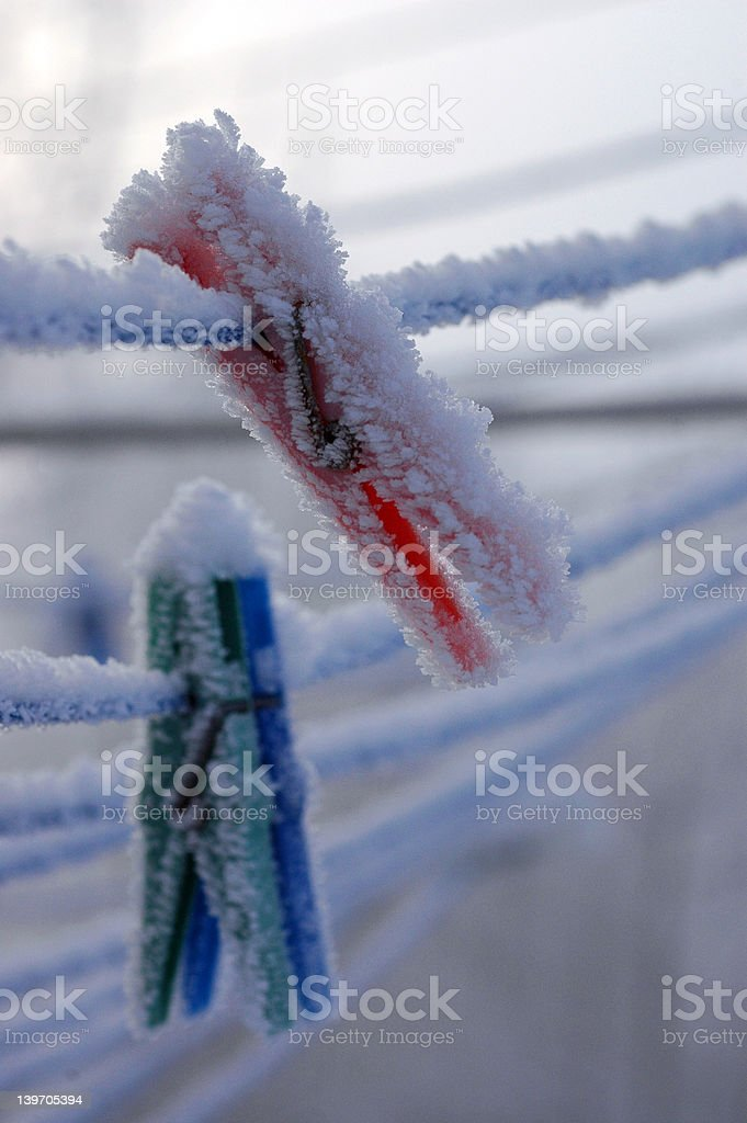 clothespins in winter royalty-free stock photo