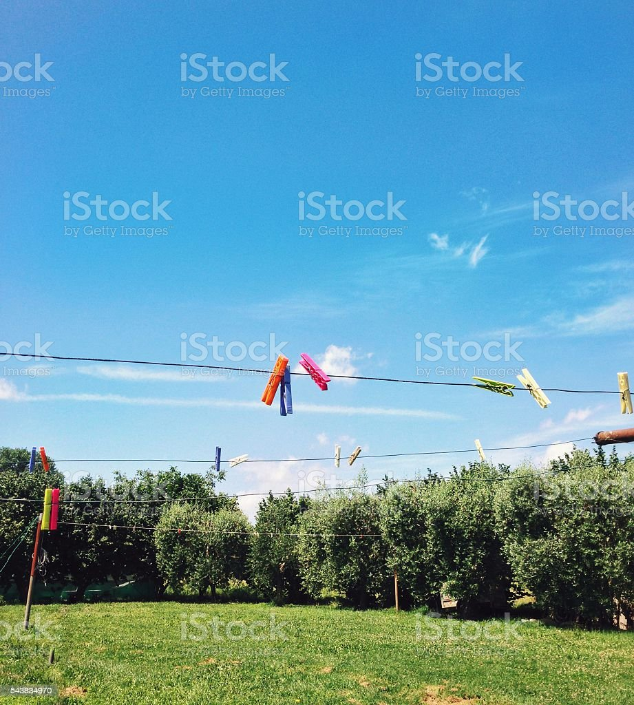 Clothespins on clothesline in the nature outdoors stock photo