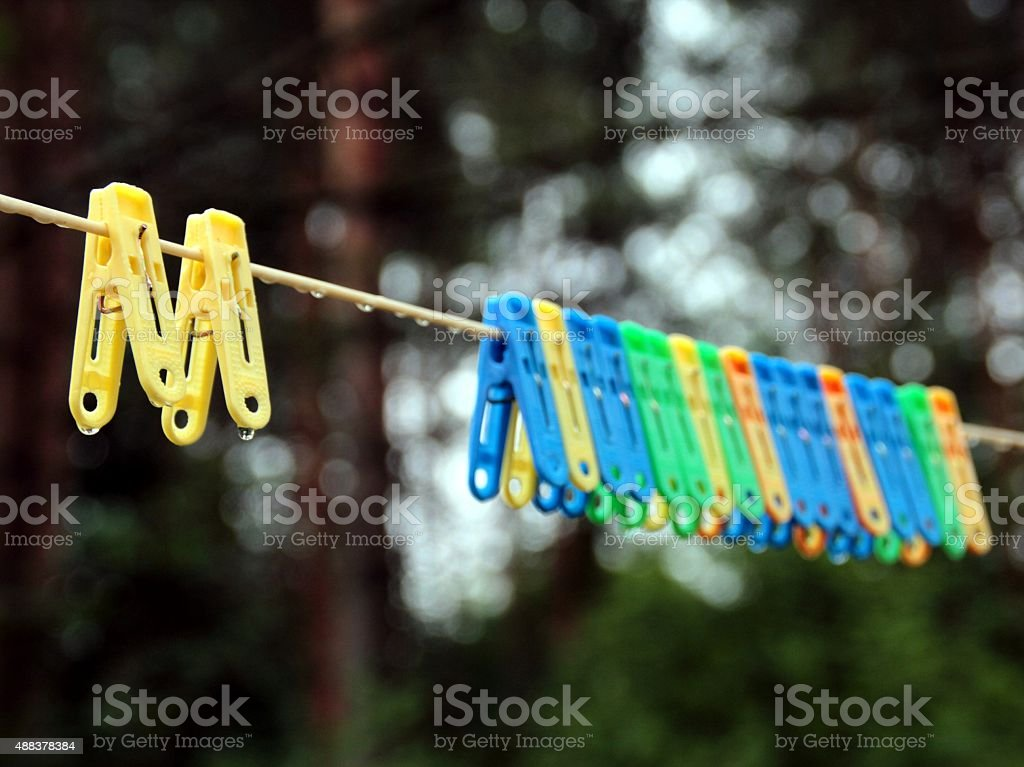 Clothespins on the clothesline after a rain stock photo