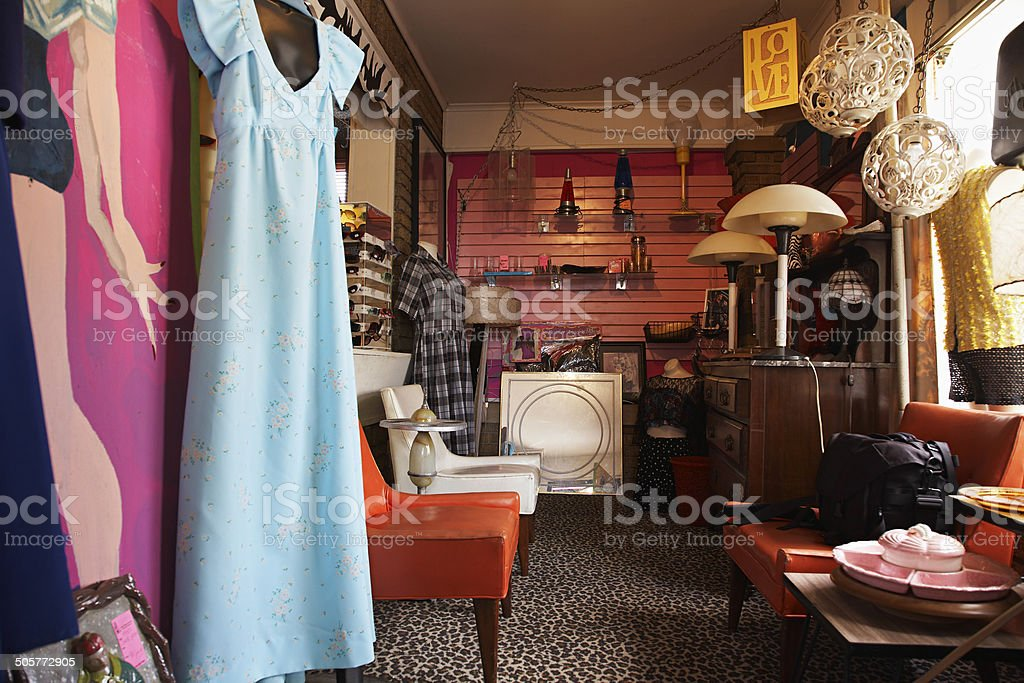 Clothing And Furniture In Second Hand Store stock photo