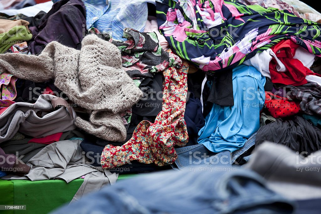 Clothing at an outdoor flea market street stall stock photo
