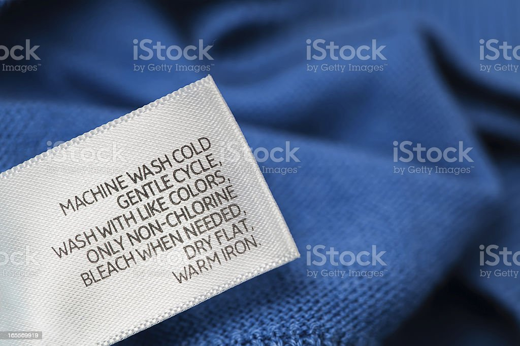 Clothing label with  laundry care instructions royalty-free stock photo